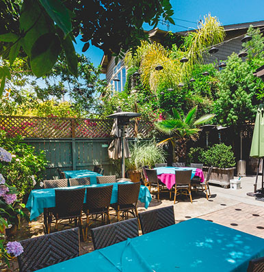 DINE IN STYLE IN OUR LUSH GARDEN PATIO SEATING