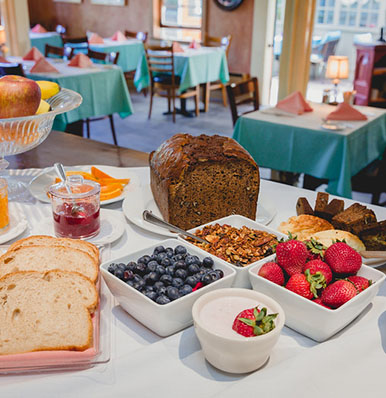 WAKE UP TO HOMEMADE BREADS, FRESH FRUITS, AND MORE